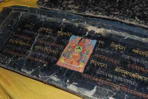 Illustrated Tibetan pecha. Photo G. Halkias.